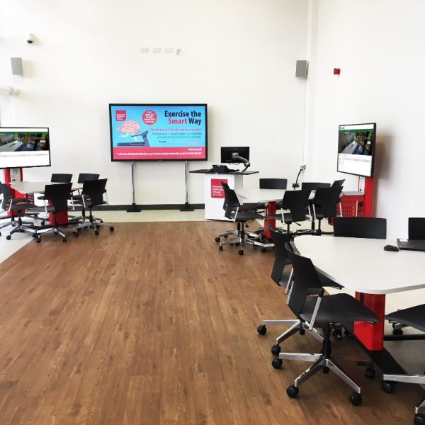 AV furniture for underutilised space at University of South Wales, three tables and lecturn